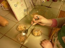 Then she spooned the mixture into tin foil baking cups. It didn't seem gross anymore!